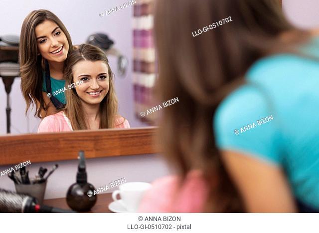 Hairdresser and customer talking in hair salon. Debica, Poland