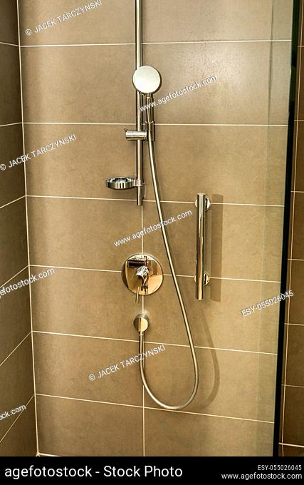 Shower cabin in a bathroom with ceramic tiles