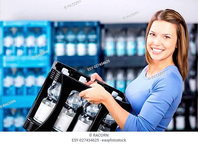 Smiling woman holding a box of refundable bottles