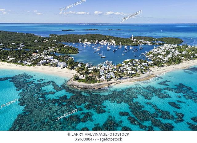 Aerial view of the harbour, beach and lighthouse in Hope Town on Elbow Cay off the island of Abaco, Bahamas