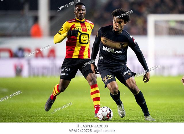 Mechelen's William Togui and STVV's Samy Mmaee fight for the ball during a soccer match between KV Mechelen and STVV Sint-Truiden