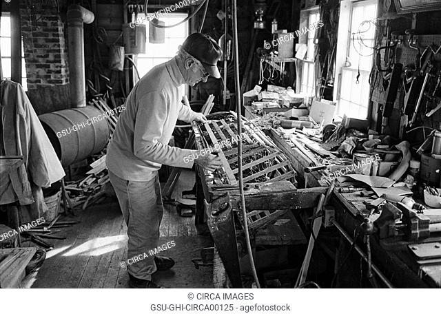 Lobsterman Repairing Traps, Maine, USA