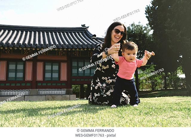 South Korea, Seoul, Mother and baby girl at Gyeongbokgung Palace