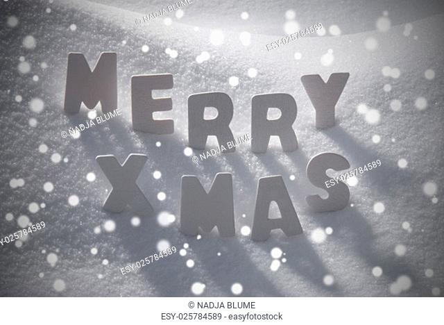 White Wooden Letters Building English Word Merry Xmas. Snow And Snowy Scenery With Snowfalkes. Christmas Atmosphere. Christmas Background Or Christmas Card For...