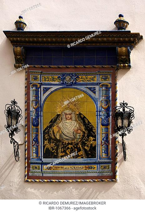 Picture of Mary on elaborate ceramics, outer wall of a church in Seville, Andalusia, Spain, Europe