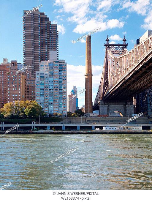 View of the Manhattan waterfront across the East River from Roosevelt Island, New York, NY, USA