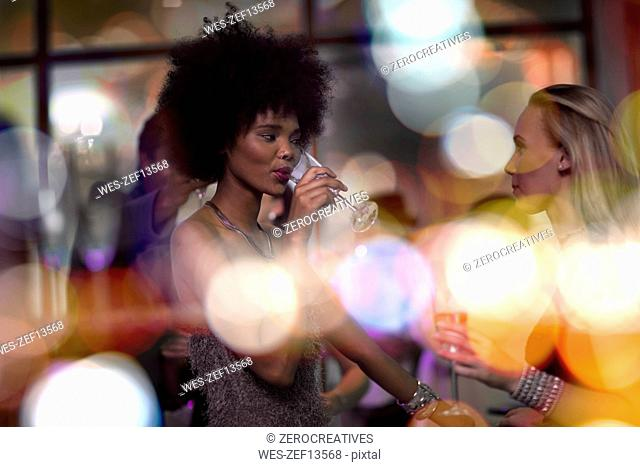 Two women socializing on a party