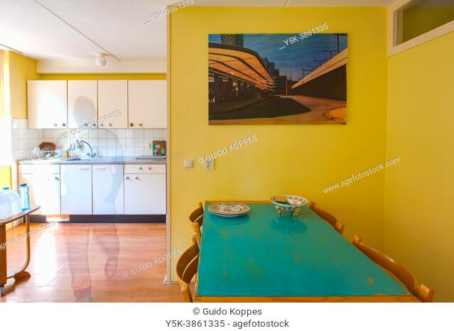 Tilburg, Netherlands. Dining room interior with analog photo art mounted on a wall to decorate the space. Recent interior design trends give more space to...
