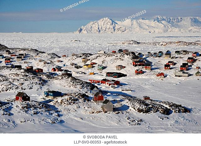Winter in a remote village Kulusuk, snowy mountain as a background, Greenland