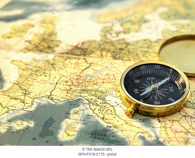 Compass sitting on a map of Europe