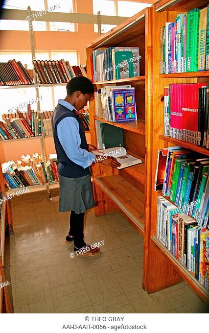 School girl in school library, St Mark's School, Mbabane, Hhohho, Kingdom of Swaziland
