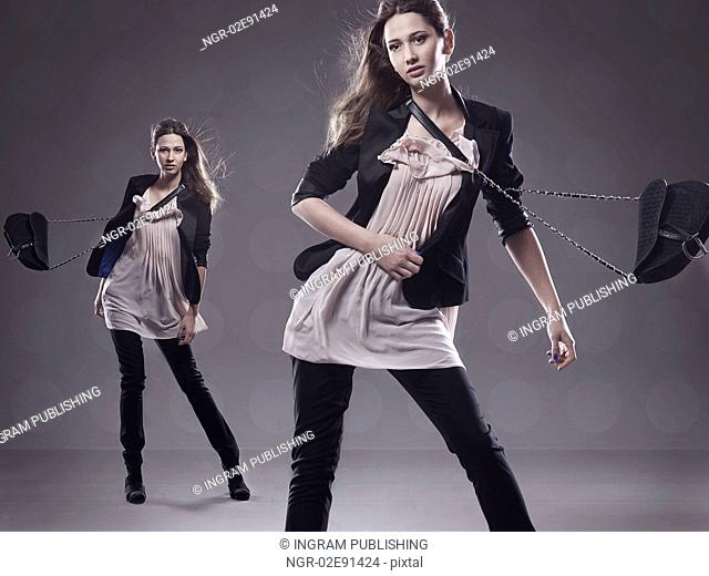 Fashion style photo of 2 young brunettes posing
