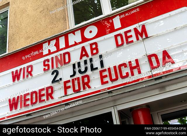 """17 June 2020, Bavaria, Munich: """"""""We will be there for you again from July 2"""""""" is written in large letters above the entrance of the Rio-Palast cinema in the..."""