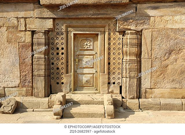 Badami - Karnataka, temple complex on the northern side of the lake. showing highly decorative doorway & pilasters in sandstone