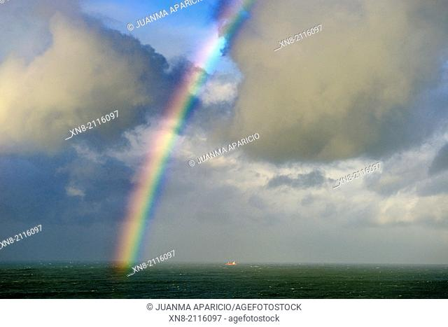 Cargo Ship under the rainbow, Santander, Cantabria, Spain, Europe