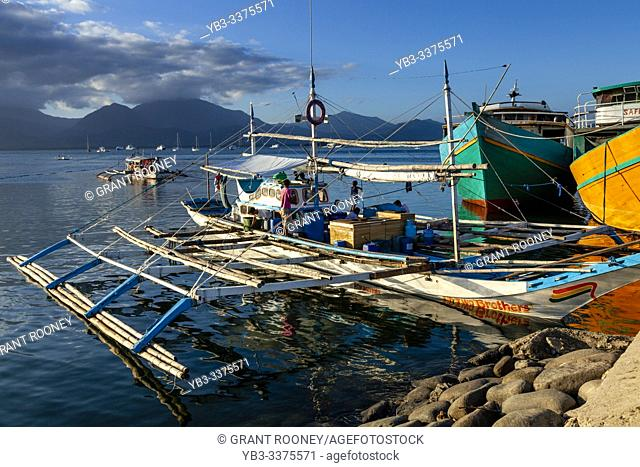 Traditional Wooden Banca Boats In The Harbour At Puerto Princessa, Palawan Island, The Philippines