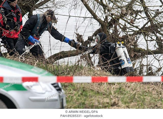 A diver of the police searches for the missing student Malina K. on the Donau river in Regensburg, Germany, 24 March 2017
