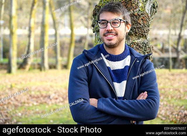 Portrait Of Young Man In Autumn Park