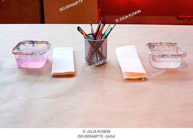 Paint brushes and utensils on table