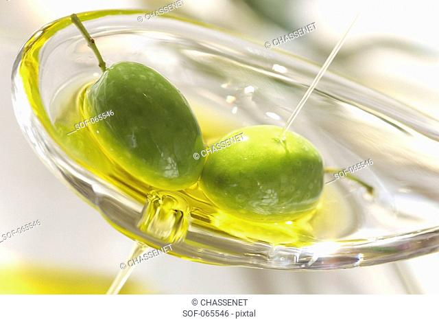 green olives in spoon