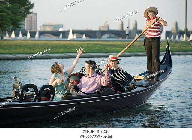 Tourists in a gondola in a river, Charles River, Boston, Massachusetts, USA