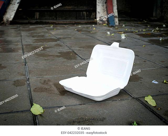 Styrofoam waste on road. Styrofoam waste from foam box for takeaway food make road dirty. Environment problems concept