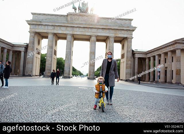 Mother and son walking in Brandenburg gate in Berlin in Corona days