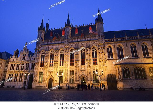 People in front of the Provincial Hof, former Government building in Burg Square by night, Bruges, Belgium, Europe
