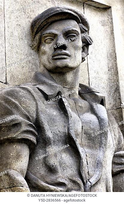 Reminders of communist era, reliefs of heroic workers. here heroic bricklayer, Marszalkowska street in Warsaw. Poland