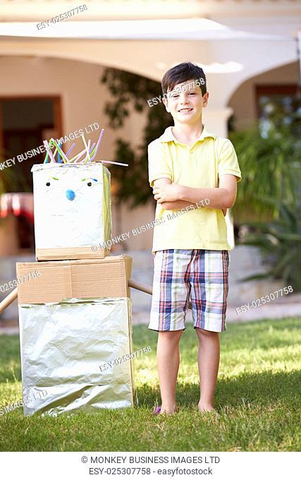Boy Standing In Garden With Homemade Robot