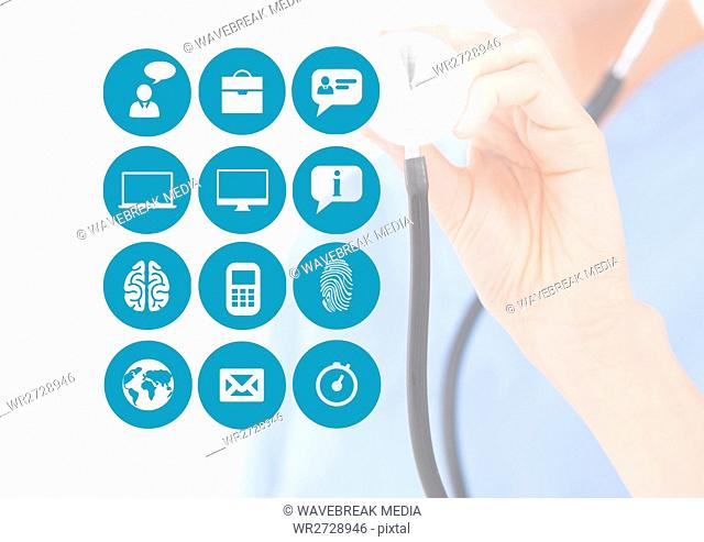 Mid-section of doctor holding stethoscope with application icons on digital screen