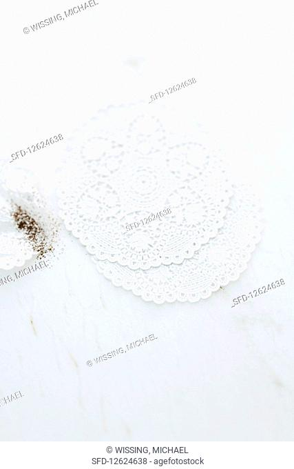 Doilies on a marble surface