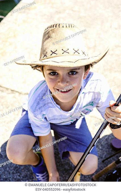 portrait of a 10 year old boy with a cowboy hat