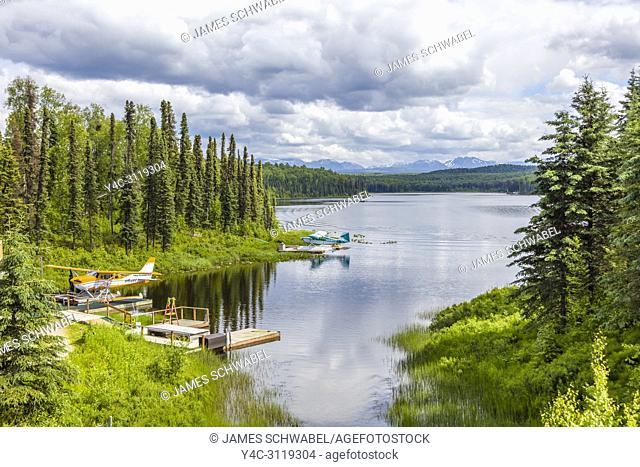 Seaplanes or floatplanes on small lake in Talkeetna Alaska