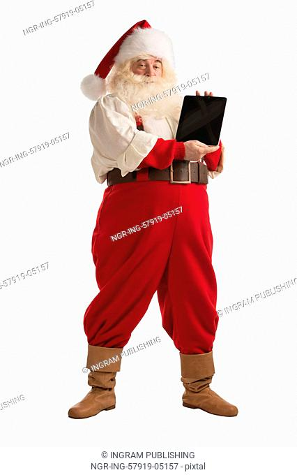 Santa Claus showing tablet computer display isolated full length portrait on white background