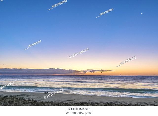 Sunrise over beach and ocean