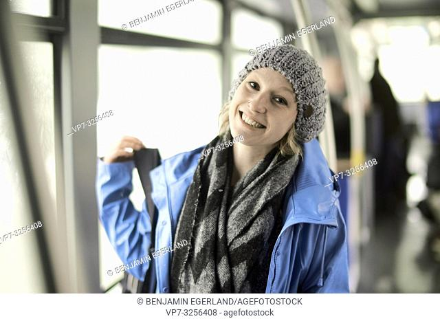 Young woman in bus, Munich, Germany