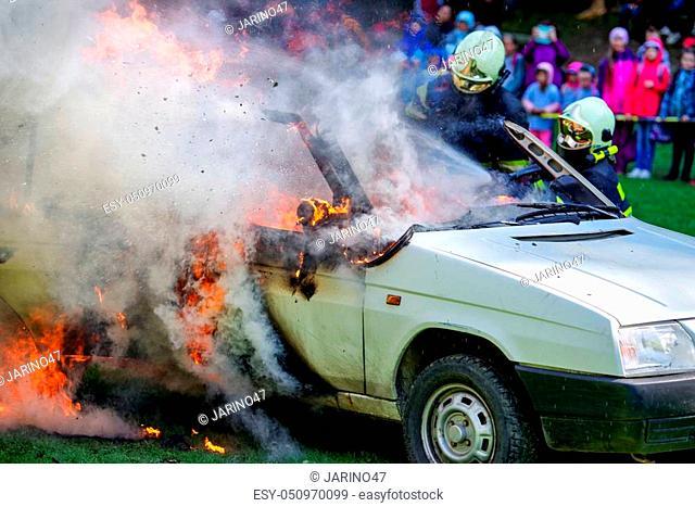 RUZOMBEROK, SLOVAKIA - SEPTEMBER 9: Firemans and burning car on September 9, 2017 in Ruzomberok