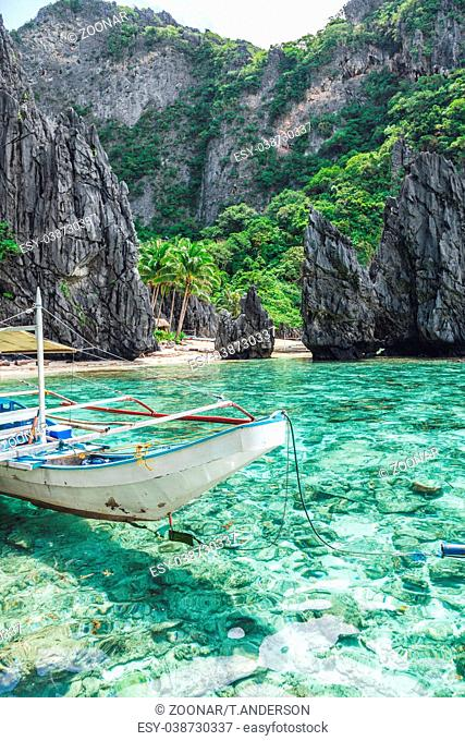 Beautiful tropical scenery with a traditional boat in El Nido