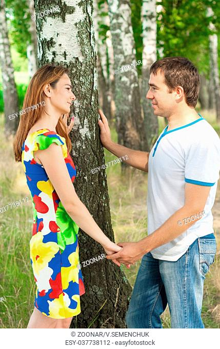 Couple of lovers holding hands outdoors