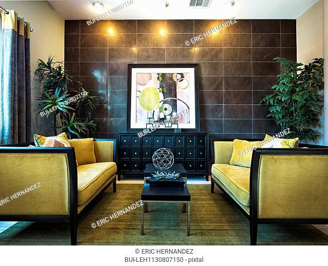 Yellow sofas in comfortable living room; Valencia; California; USA