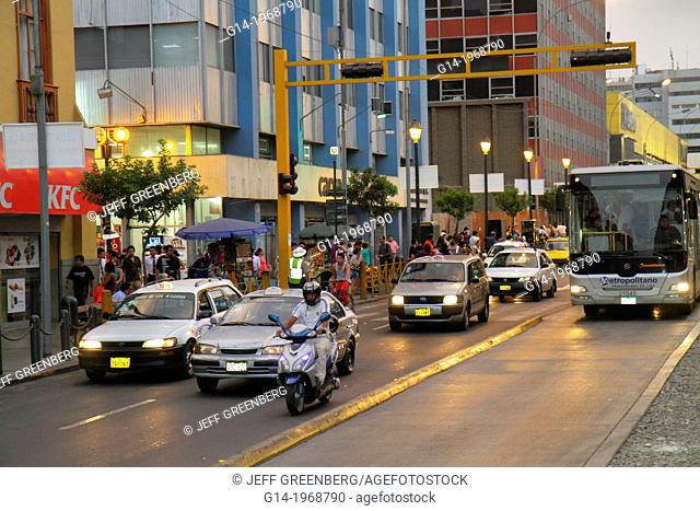 Peru, Lima, Avenida Emancipacion, street scene, traffic, moving, headlight, bus, car, motorcycle, bus lane, sidewalk, pedestrian,