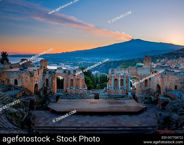Ruins of Ancient Greek theatre in Taormina on background of Etna Volcano, Italy. Taormina located in Metropolitan City of Messina