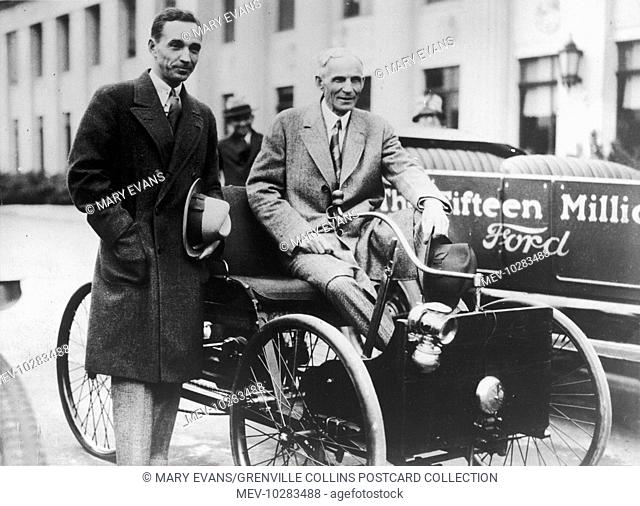 Henry Ford (1863 - 1947) and his son Edsel Ford (1893 - 1943) seated in the Quadricycle (1890s) alongside the 15, 000, 000th Ford produced