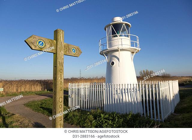 Wales Coast Path, signpost and East Usk lighthouse, at Newport Wetlands