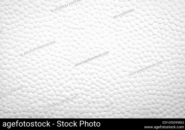 White concrete wall texture background decor with small round convex dot. White cement wall of building. Art background. Exterior or interior decor concept