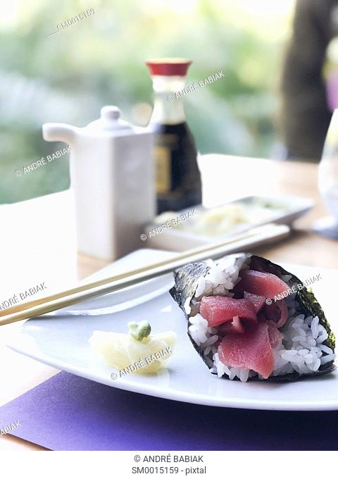 Tuna sushi handroll with sliced ginger and wasabi