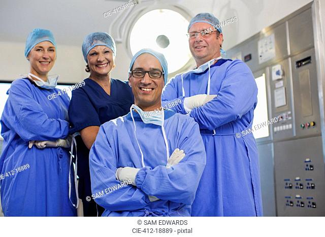 Team of doctors wearing surgical clothing in operating theater