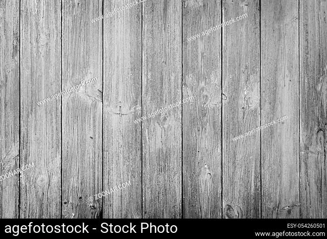 Background image: a fragment of an old wall, covered with wooden panels with a pronounced structure of wood
