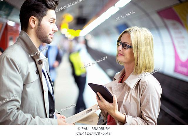 Business people talking in subway station